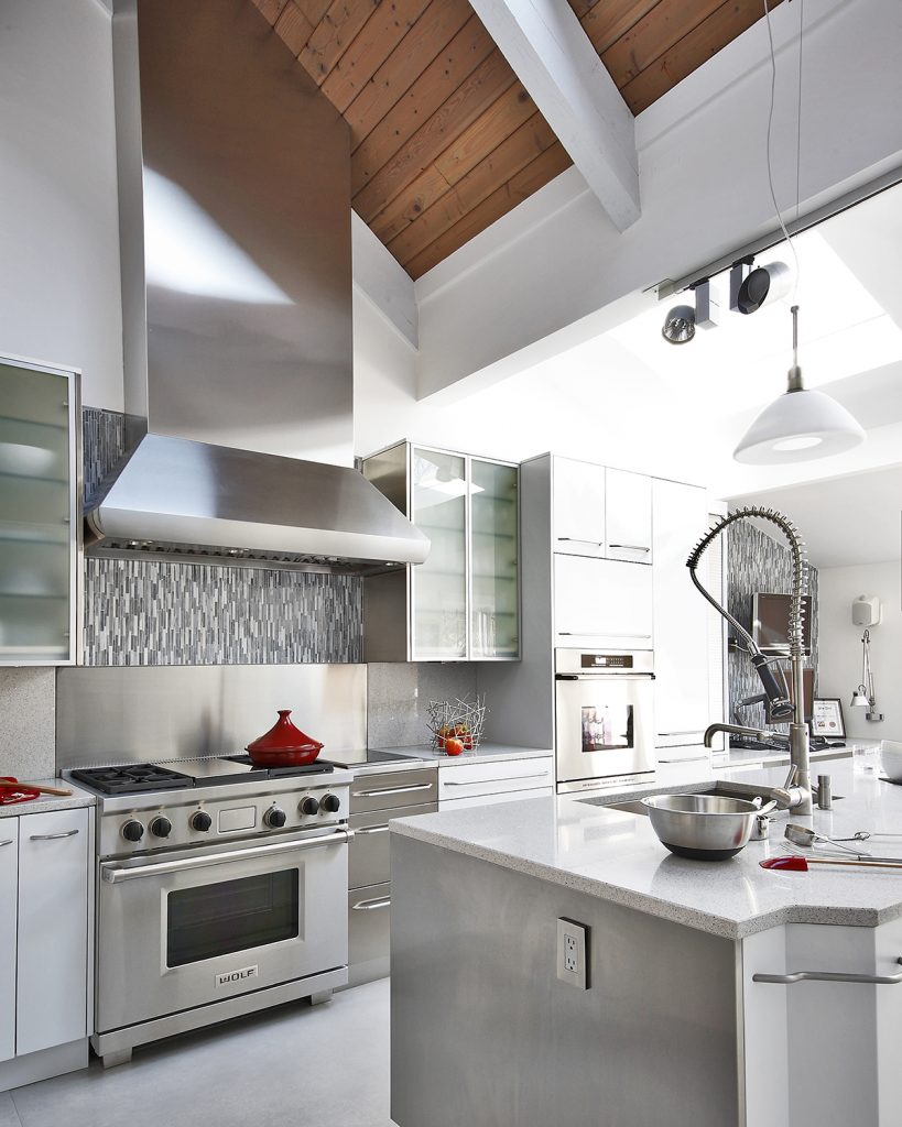 designer builds career on custom design kitchen bath design this stainless steel and custom paint neff kitchen was designed for a serious cook in baltimore wolf appliances sub zero refrigeration and silestone