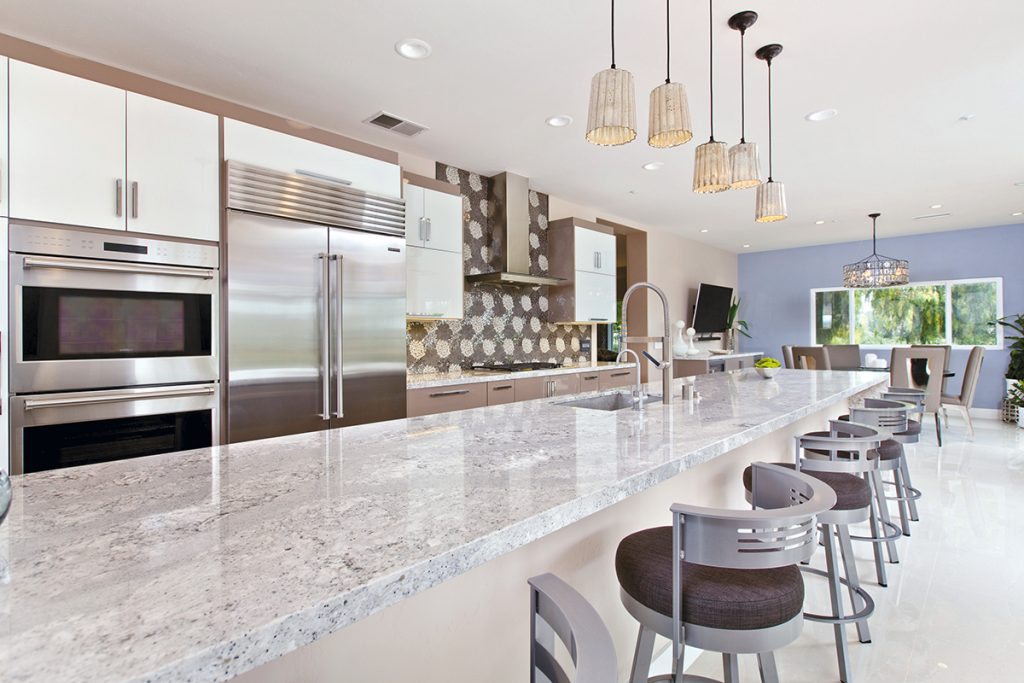 ... Glass Wall Cabinets And High Gloss Lacquer Flat Paneled Cabinetry With  The Focal Point Backsplash Of Intricate Mosaic Tiles. Ovation Cabinetry Was  Used ...