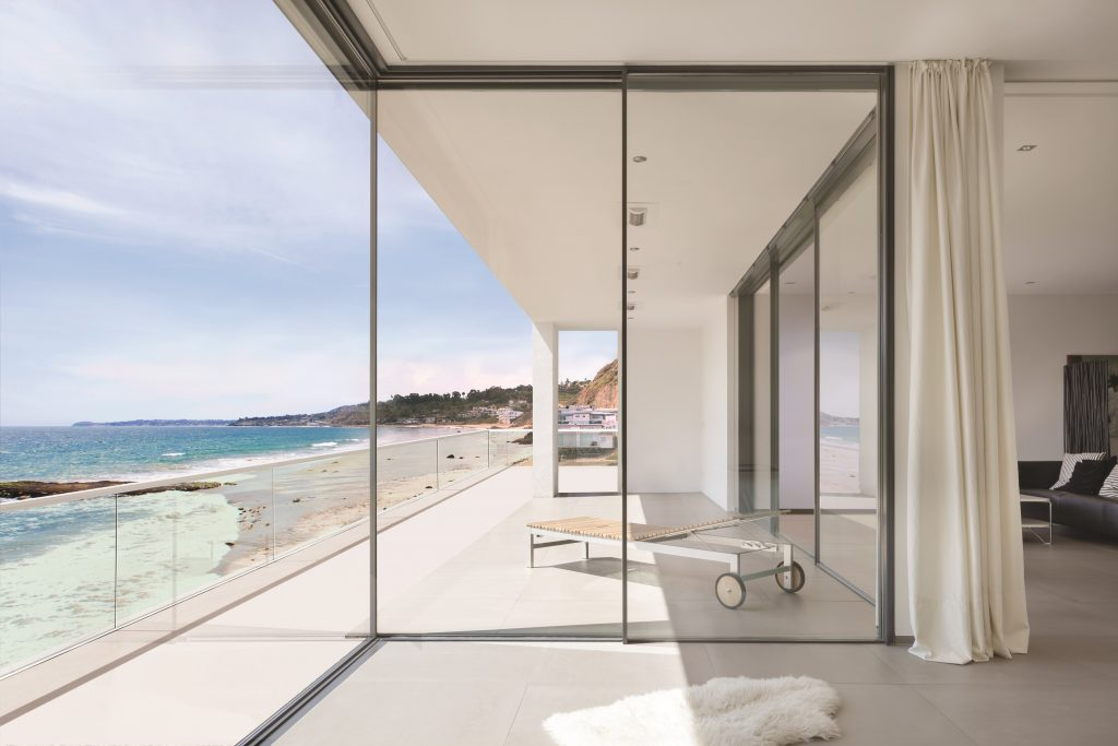 minimal framed sliding glass wall system for residential