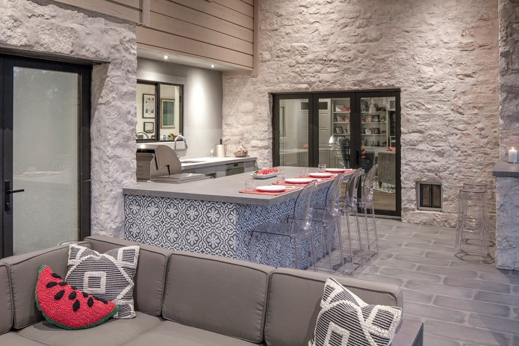 Creating An Outdoor Kitchen With A Grill Was Top Priority, So CGu0026S  Installed One With A Counter And Sink, Tucked Against The Exterior Wall.