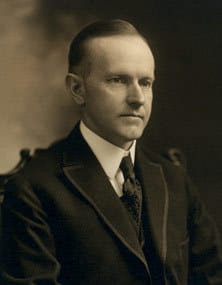 Calvin_Coolidge _bw_head_and_shoulders_photo_portrait_seated_1919