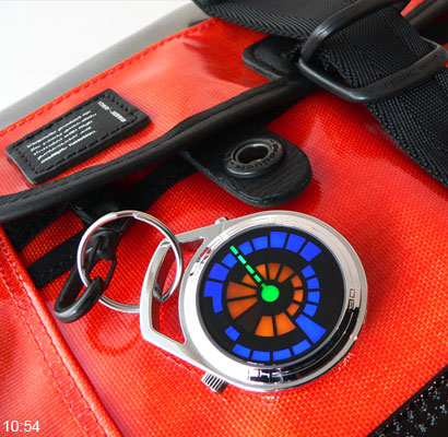 LED Pocket watch Round Trip attached to bag