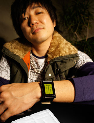 Guy wearing Stencil Green LCD watch
