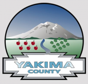 the Yakima County, WA logo of depicting Mt. Rainier, fruit trees, forest trees and the river.