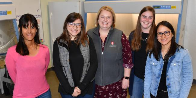 WSU scientists stand together in the BL2 Core Lab