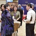 Ana Mari Cauce with UW alumni at a reception in Beijing