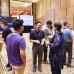 President Cauce speaking with two Beijing-area UW alumni