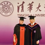 President Cauce and Tsinghua President Qiu pose for photgraphs in graduation cap and gown