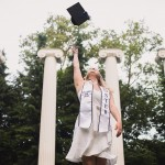 Hannah tossing her graduation cap in the air at Sylvan Grove