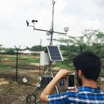 UW student Shahryar Ahmadhelps set-up an automatic weather station thatmeasures weather parameters in real time.