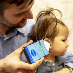 Dr. Randall Bly, an assistant professor of otolaryngology-head and neck surgery at the UW School of Medicine who practices at Seattle Children's Hospital, uses the app and funnel to check his daughter's ear.