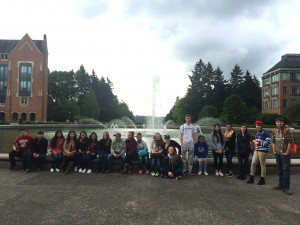 A group of Sedro Woodley High School students taking picture in front of the UW fountain