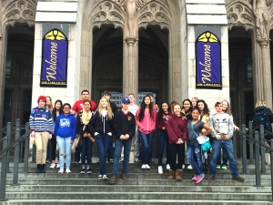 A group of Sedro Woodley High School students taking a group picture in front of Suzzallo Library