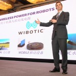Ben Waters, Ph.D. candidate in electrical engineering and CEO of WiBotic Inc., presents his research on wireless power for heart assist devices and robots at the University of Washington's inaugural Innovation Summit, held November 13 in Shanghai, China.