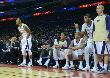 Players on the bench cheer on their teammates