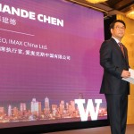Jiande Chen, CEO of IMAX China Ltd., greets attendees to the University of Washington's inaugural Innovation Summit, held November 13 in Shanghai, China. A UW alumnus, Chen served as honorary chair of the summit.
