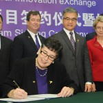 University of Washington President Ana Mari Cauce signs an agreement with Tsinghua University Nov. 9 in Beijing creating an integrated dual degree program through the Global Innovation Exchange (GIX).