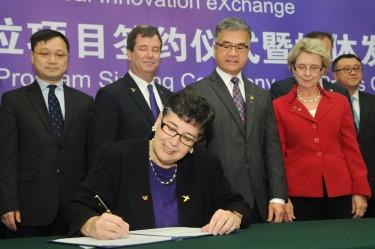 University of Washington President Ana Mari Cauce signs an agreement with Tsinghua University Nov. 9 in Beijing creating an integrated dual degree program through the Global Innovation Exchange (GIX).