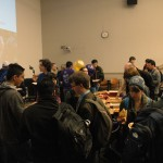 Picture of students eating pizza