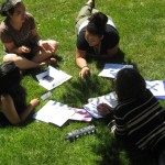 Picture of students talking on the grass
