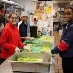 Students pose while preparing food during MLK week 2018.