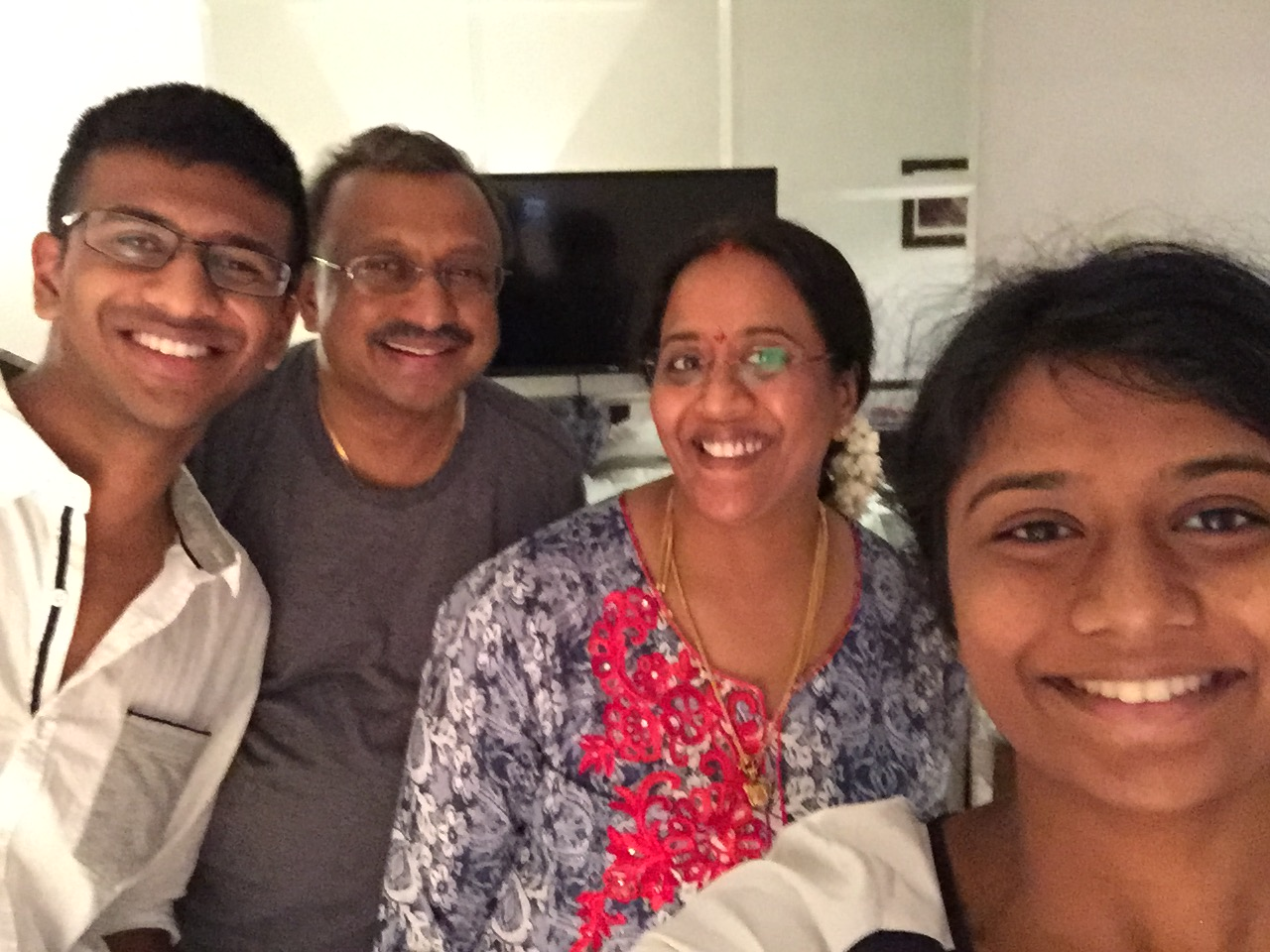 Living so close to India, Varsha got to visit family she hadn't seen in 14 years.She's pictured here with her parents and brother.