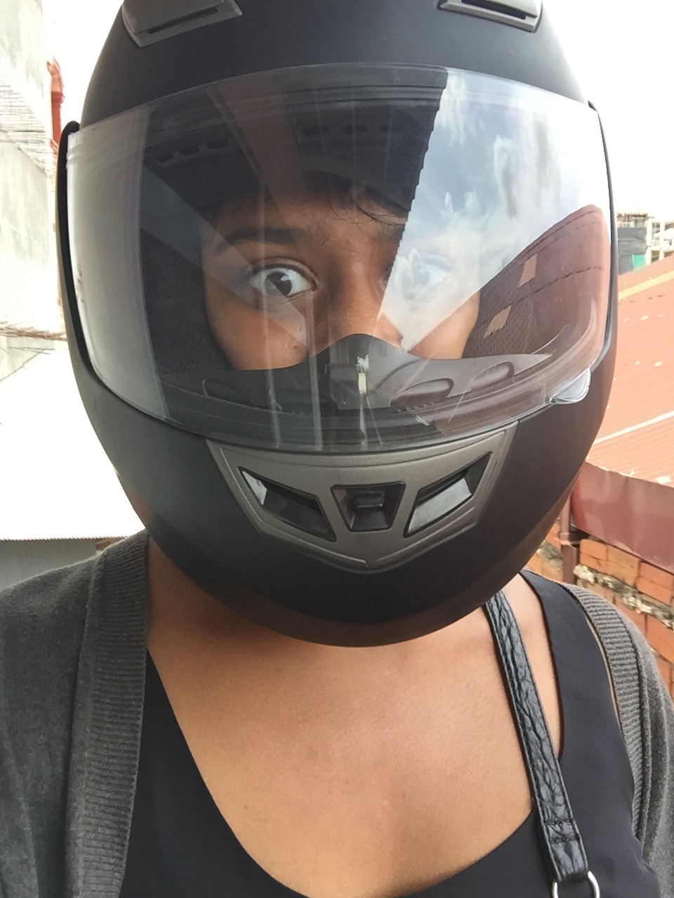 Safety first! Varsha models her motorcycle helmet.