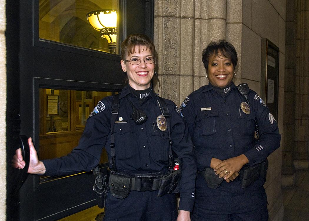 UW Detective Ginger Banyai-Riepl, right, and Tawan Pratt-Wieburg.| Photo by Mary Levin.