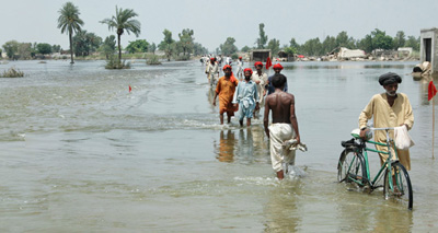 This photo, taken long after the initial floods hit in late July 2010, shows the significant effect of the monsoon on roads in the Muzaffargarrh district near central Pakistan. (Photo credit: World Vision)