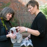 Ginna Wall (left) and Karen Carlson compare running shoes on a recent sunny day in Seattle.