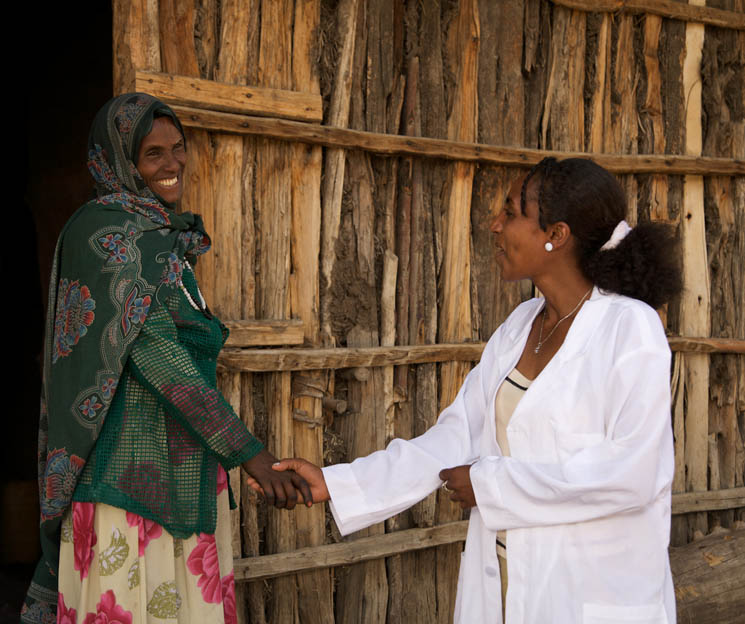 An outreach worker arrives for a home visit in a rural community near Dessie, Ethiopia. I-TECH pioneered the use of case management and outreach workers for public sector AIDS care, a program that has since been adopted by the Ethiopia Ministry of Health.