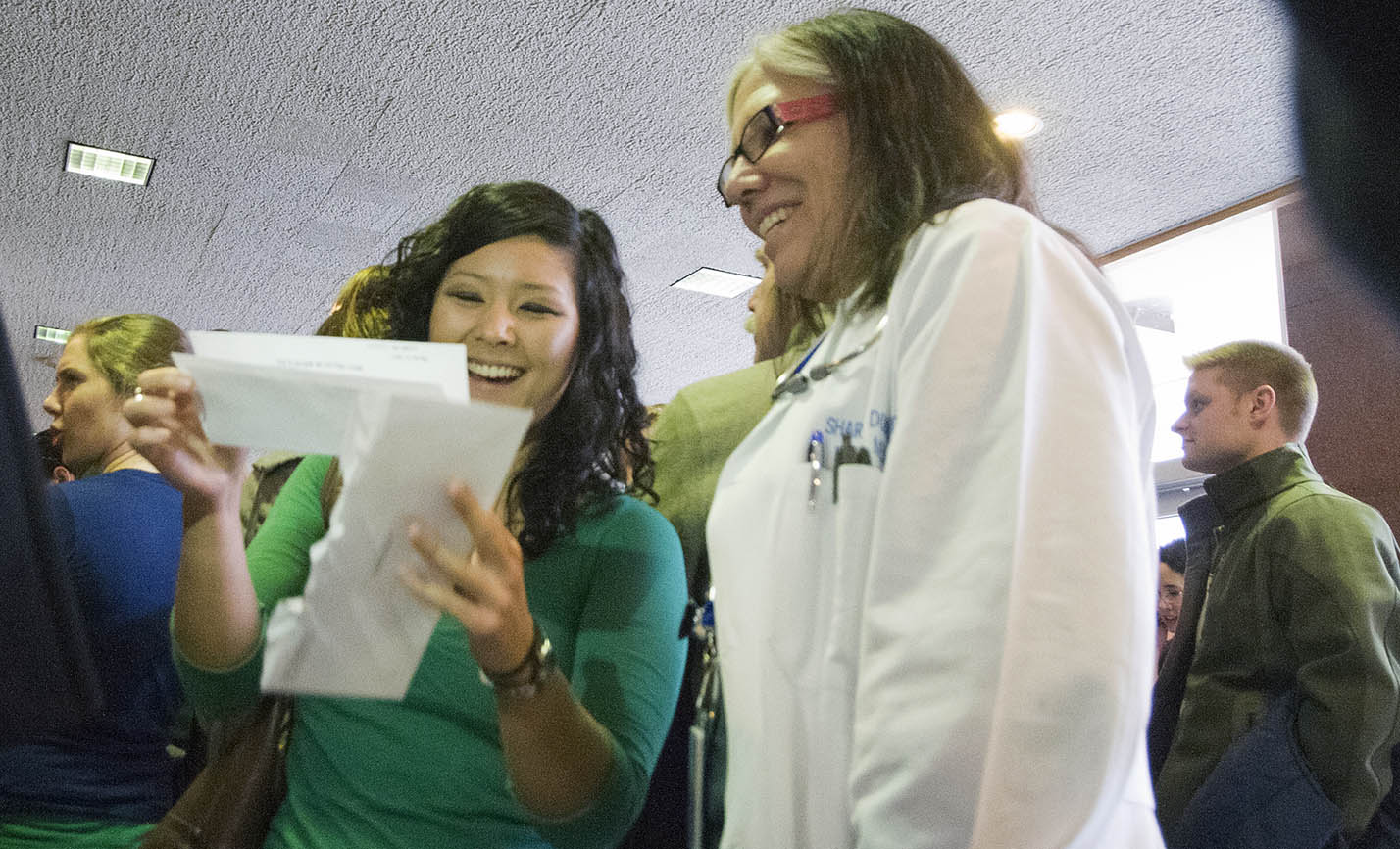 Emily Glynn shows her match results to one of her mentors, Dr. Sharon Dobie, professor of family medicine.