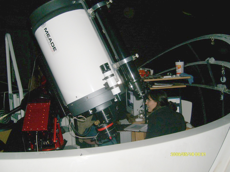A student astronomer uses the 16 inch Meade 200ACF telescope on the A wing deck of the Physics/Astronomy Building.    This is the telescope that the Protostars members would use for their observations.