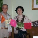 Hiroya and Sakuko Oda of Sendai, Japan, display their Prayer Flags of Hope from Seattle.