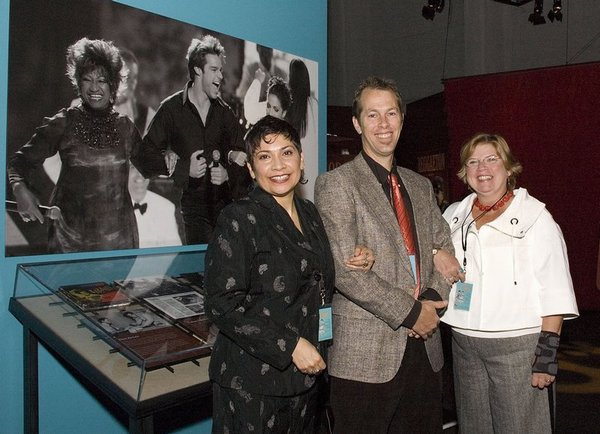 The three guest curators of 'American Sabor: Latinos in U.S. Popular Music.' From the left, they are Michelle Habell-Pallán, Shannon Dudley and Marisol Berríos-Miranda. Behind them in a similar pose are Latino performers Celia Cruz, Ricky Martin and Gloria Estefan. The exhibit ran at the EMP is 2007-08, and now will run at the Smithsonian Institution.