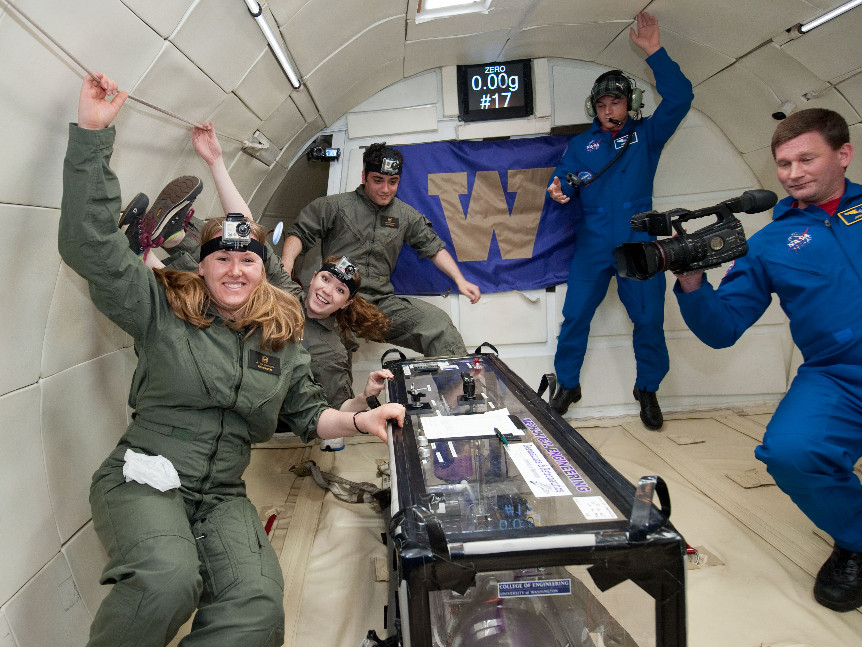 Seniors Alyssa Sorenson, Jamie Waldock and Sasan Boostani with the experiment they built to test in microgravity. The monitor on the wall shows that the gravity is zero. NASA employees accompanied the students and filmed the experiments.