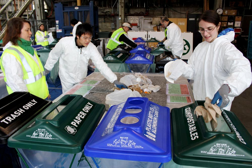 UW volunteers sort recyclable  and compostable material at the 2011 UW Trash-In. From left, they are Nanda Guajardo of Recycling & Solid Waste, and students Martin Su and Krysta Yousoufian, both members of SEED (Students Expressing Environmental Dedication).