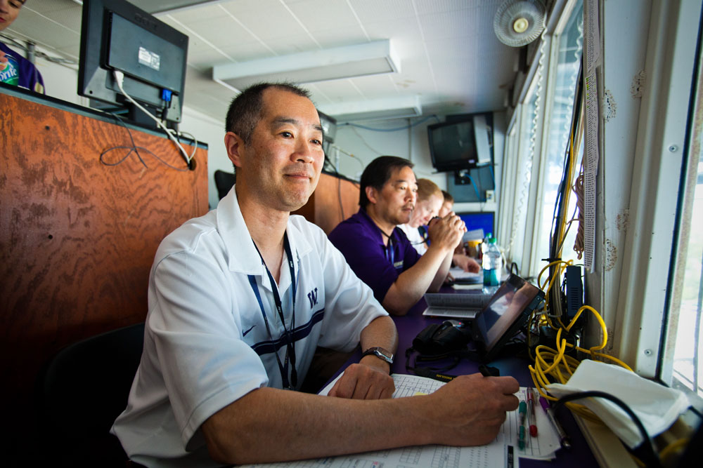 From left, Craig Heyamoto, his brother Gary Heyamoto and Dan Lepse are ready to keep statistics for another Husky game.
