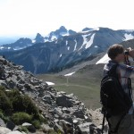 Tom Cotner is surrounded by the beauty of Rainier National Park, but hes focused on looking for a white-tailed ptarmigan hed seen on previous trips. Cotner is a regular at the UWs Birders Brown Bag group.