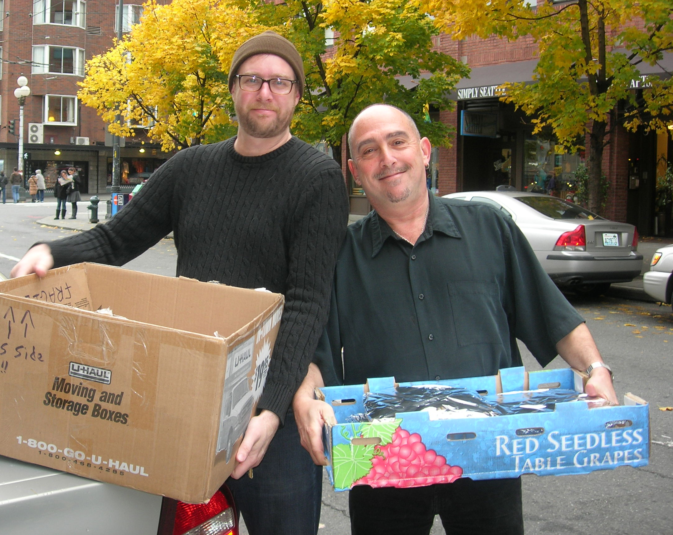 Plymouth Housing Group employees Brian Hatfield and Alan Berliner take Rameys food delivery at the Gatewood Apartments near the Pike Place Market.