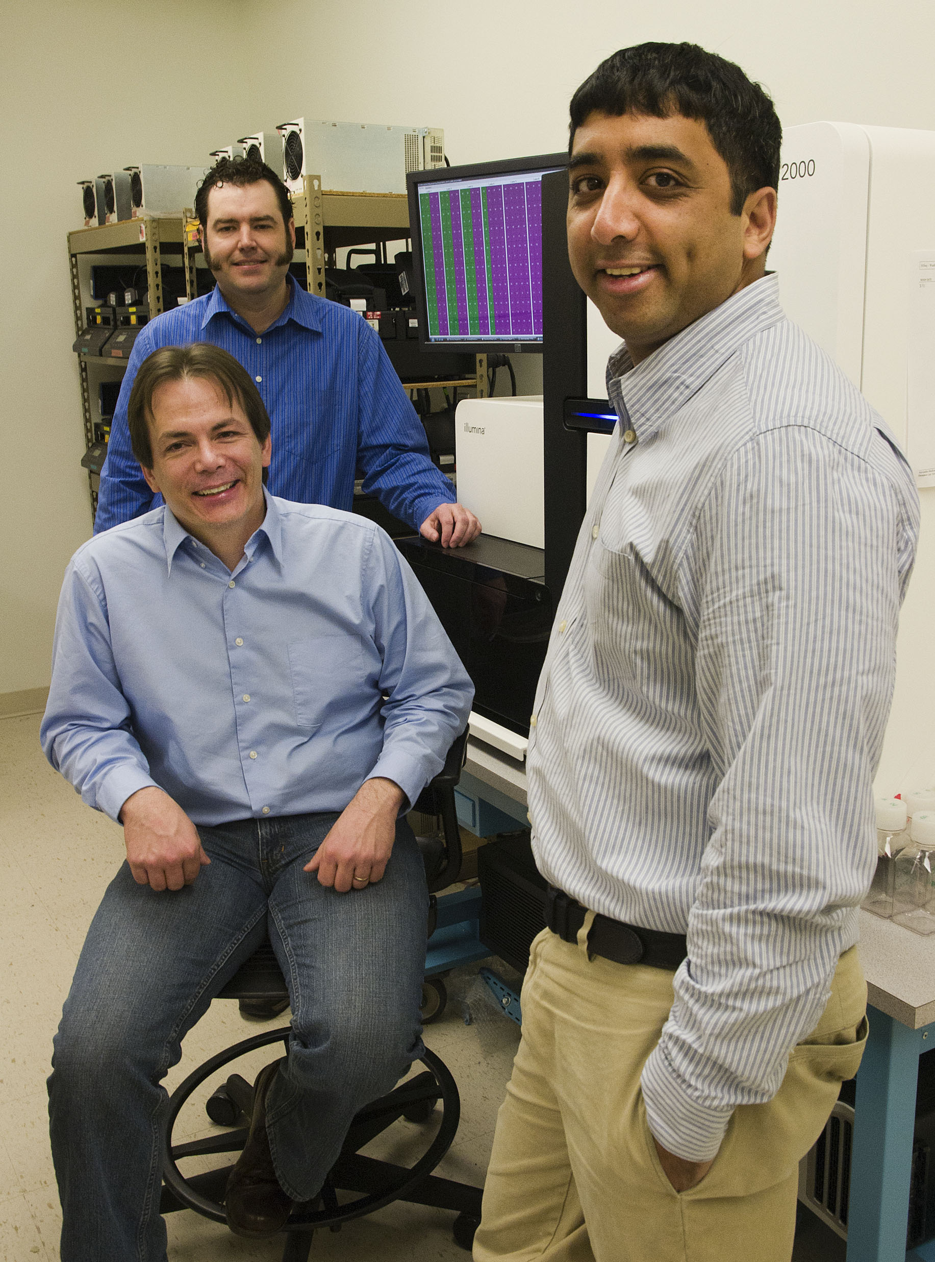 Brian O'Roak, Evan Eichler (seated) and Jay Shedure (right) in one of the UW labs where researchers search for sporadic mutations associated with autism.