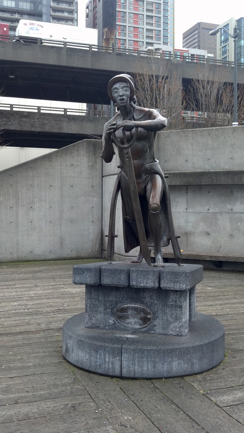 This statue of Christopher Columbus in Waterfront Park was dedicated in 1978. The City of Seattle tends to cover it near Columbus Day to protect from vandalism.