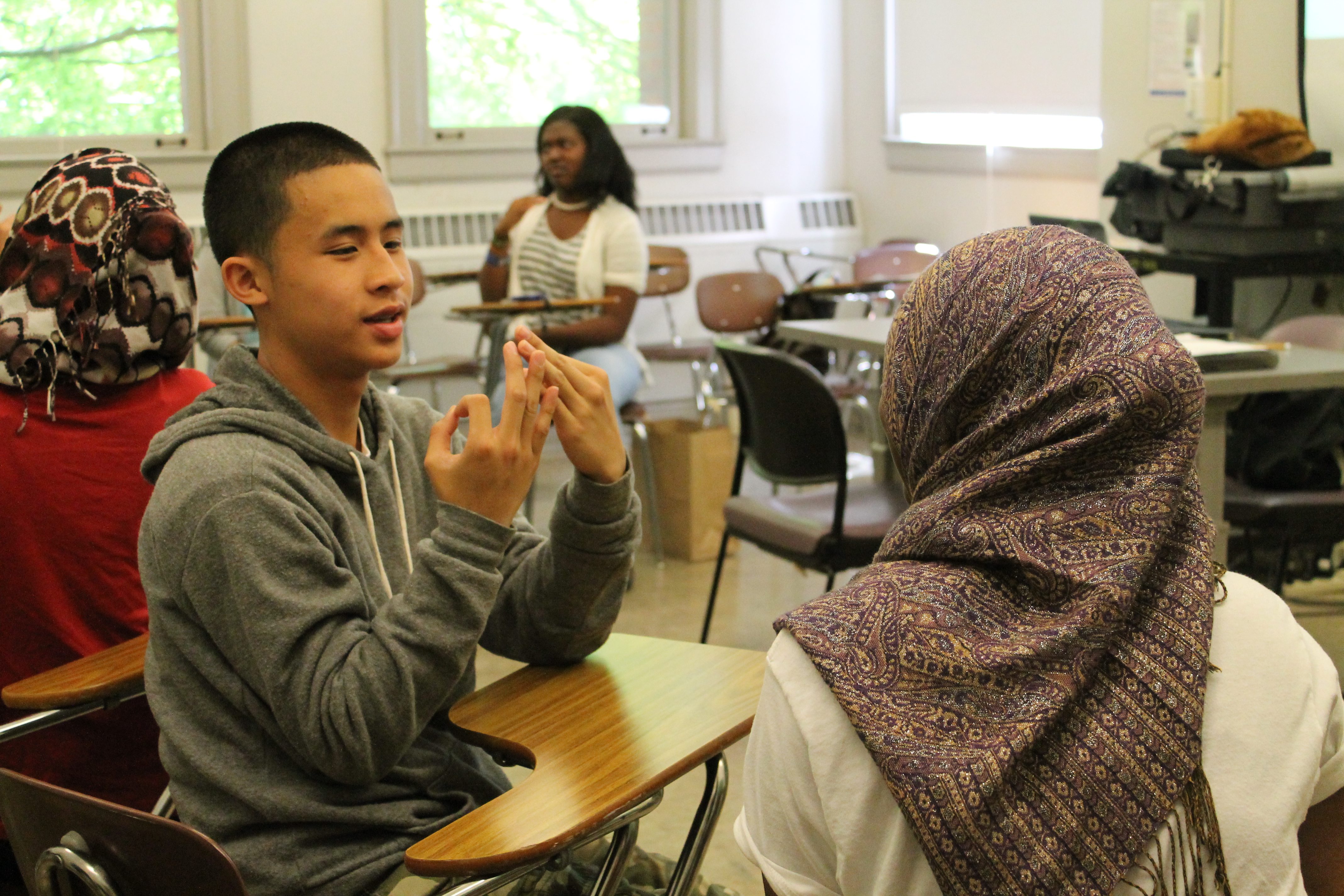 High school students practice American Sign Language, one of the elective classes offered by the Upward Bound summer program for students from low-income families.