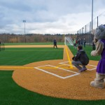 Catcher and mascot behind homeplate of new field