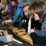 Burke Museum staff examine an item at Artifact ID Day.