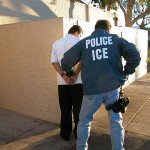 An Immigration and Customs Enforcement arrests a suspect.