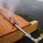 Pipe with two nozzles spraying mist into air