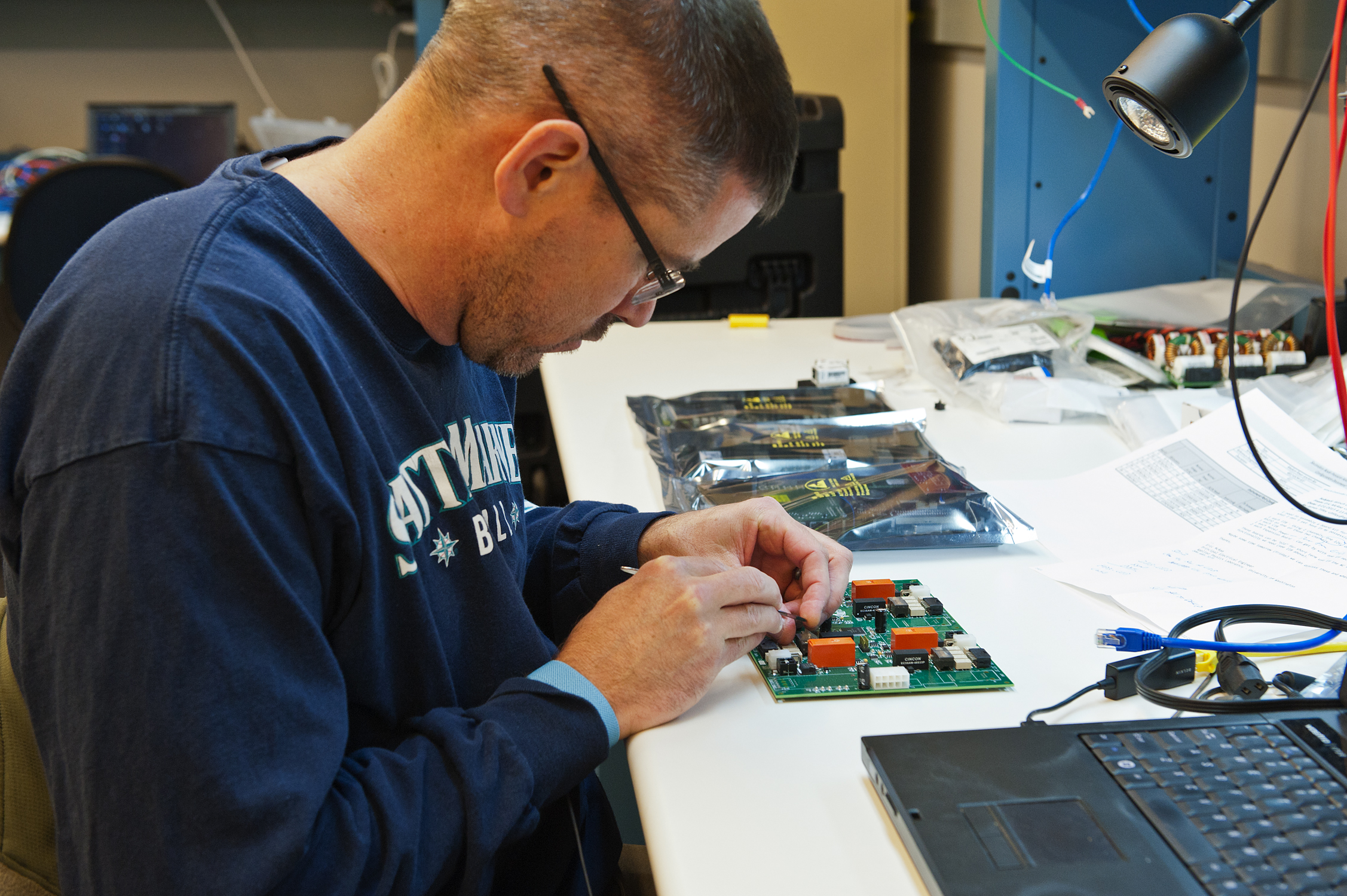 Person working on circuit board
