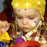 Child in autism study plays with toys