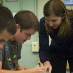 Kat Steele, an assistant professor of mechanical engineering in the UW College of Engineering, works with students.